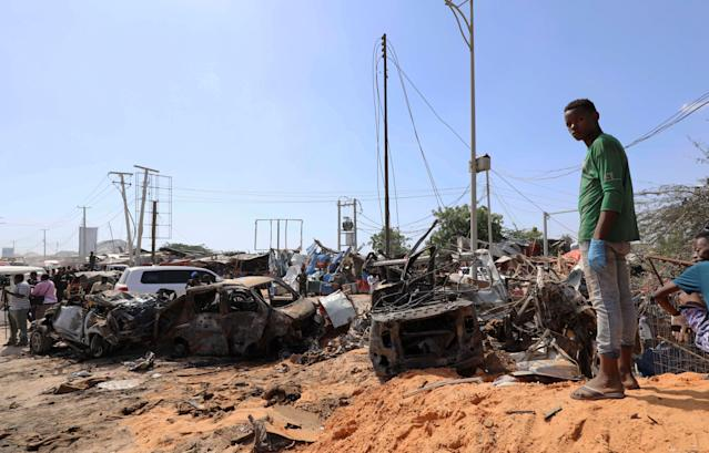 A Somali man stands at the scene of a car bomb explosion at a checkpoint in Mogadishu (Picture: Reuters)
