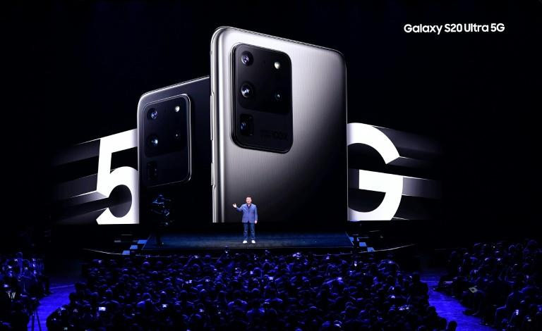 "Samsung executive TM Roh speaks at the Galaxy Unpacked 2020 event in San Francisco where the South Korean giant unveiled its ""Z Flip"" folding handset, along with a 5G smartphone (AFP Photo/Josh Edelson)"