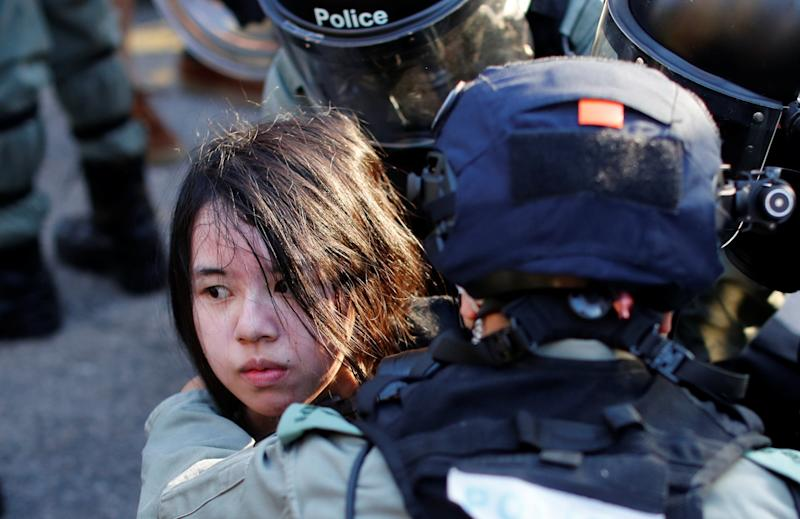 An anti-government protester is detained during a march in Tuen Mun, Hong Kong (REUTERS)