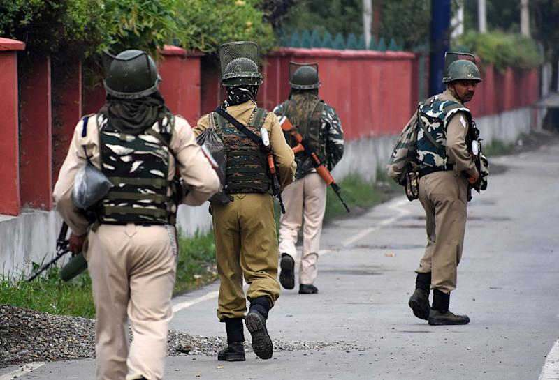 Indian soldiers patrol the deserted street during the official celebration of India's Independence day in Srinagar,Kashmir on August 15, 2019. Restrictions continues as the government has suspended cellular network ,internet services,schools and colleges across the Kashmir valley are shut to prevent protest and demonstrations.People in the valley have collected stock essentials because of the fear of an offensive from the Indian forces after the Indian governemnt abrogated the controversial Article 370. (Photo by Faisal Khan/NurPhoto via Getty Images)