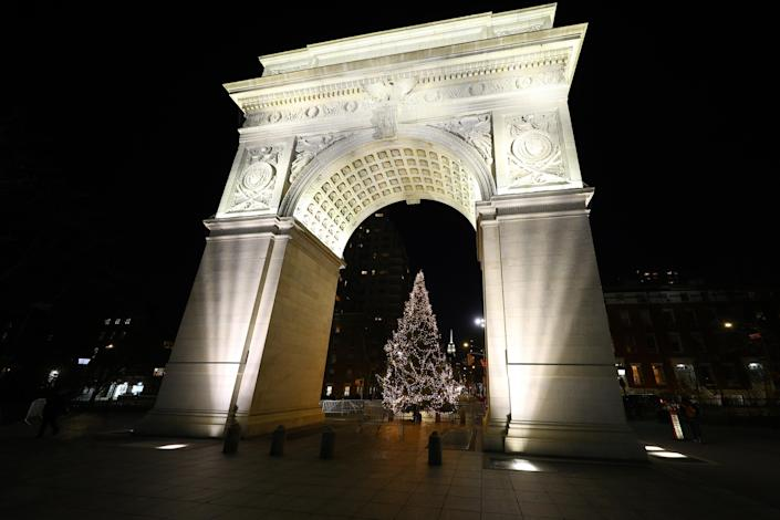 A Christmas stands near the Washington Square arch in Greenwich Village. (Photo: Gordon Donovan/Yahoo News)