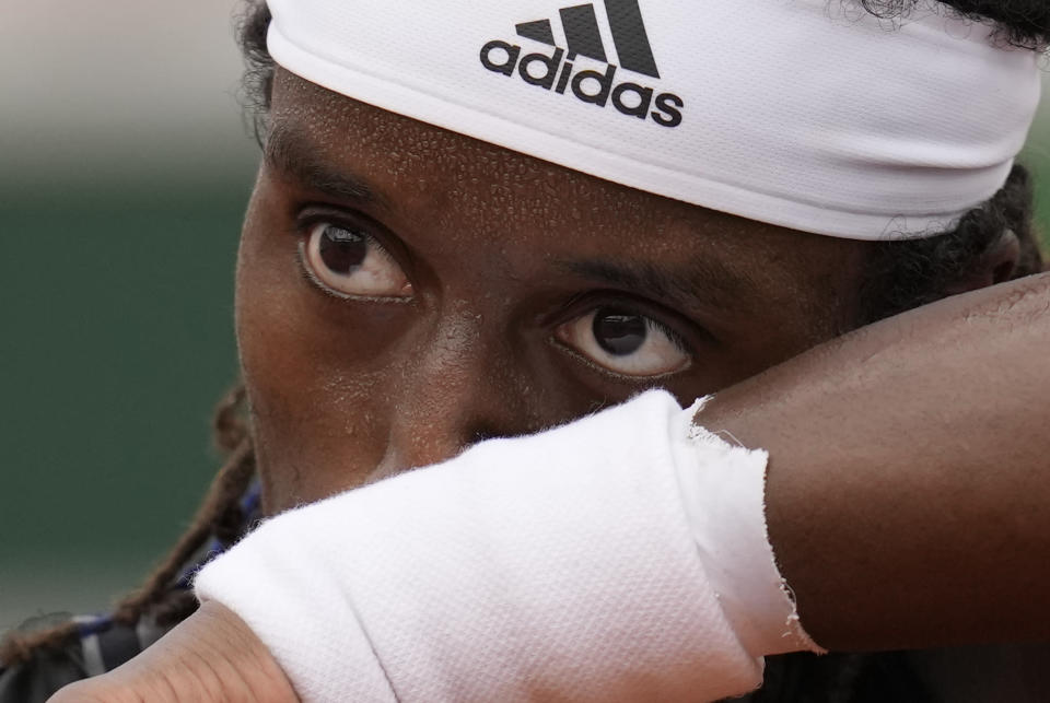Sweden's Mikael Ymer wipes his face as he prepares to serve to Gael Monfils of France during their second round match on day 5, of the French Open tennis tournament at Roland Garros in Paris, France, Thursday, June 3, 2021. (AP Photo/Christophe Ena)