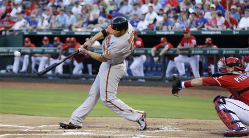 Baltimore Orioles' Chris Davis hits an RBI single in front of Texas Rangers catcher A.J. Pierzynski during the first inning of a baseball game Saturday, July 20, 2013, in Arlington, Texas. (AP Photo/LM Otero)