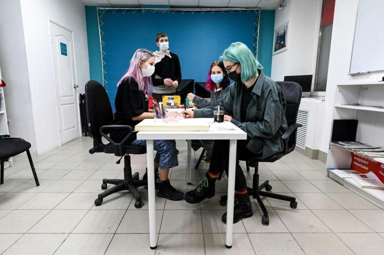 Activists prepare placards for an upcoming protest rally. Many in the Urals city of Perm, 1,200 kilometres (750 miles) east of Moscow, are angry, pointing to a city in decline