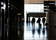 British tourists walk while leaving the airport after arriving from London, amid the spread of the coronavirus disease (COVID-19) In Telde