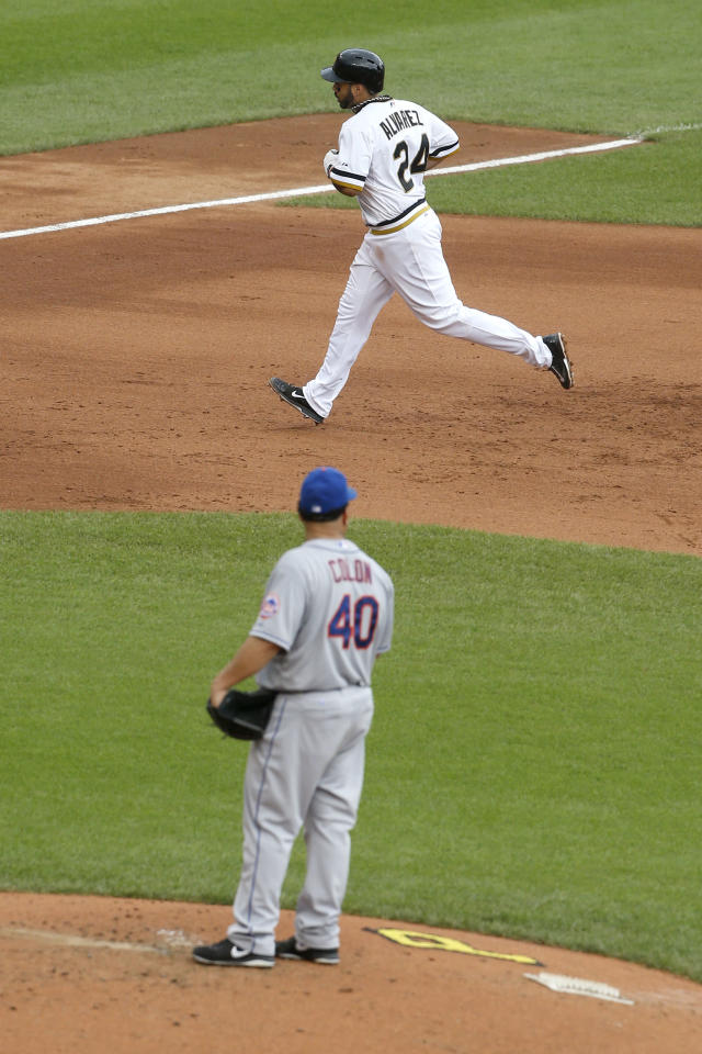 Pittsburgh Pirates' Pedro Alvarez (24) trots around the bases behind New York Mets starting pitcher Bartolo Colon (40) after hitting a two-run home run off him in the fourth inning of the baseball game on Sunday, June 29, 2014, in Pittsburgh. (AP Photo/Keith Srakocic)