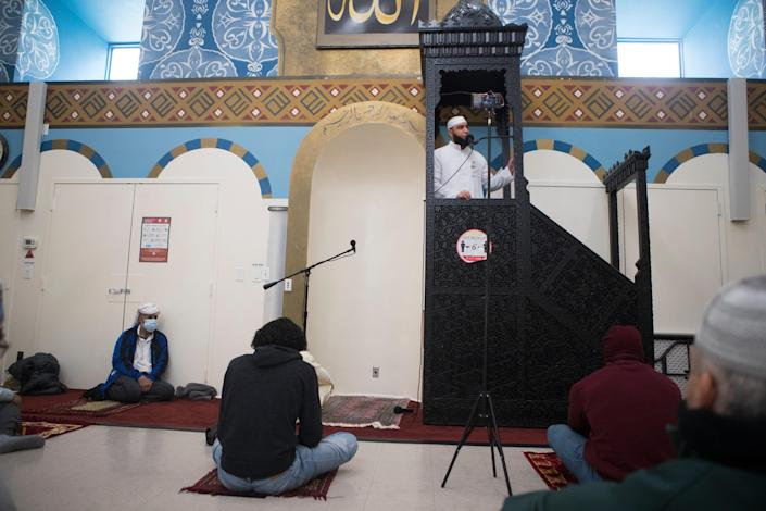 Imam Hadi Shehata leads Friday prayers Friday, April 2, 2021, at Masjid Ibrahim mosque in Newark, Delaware.