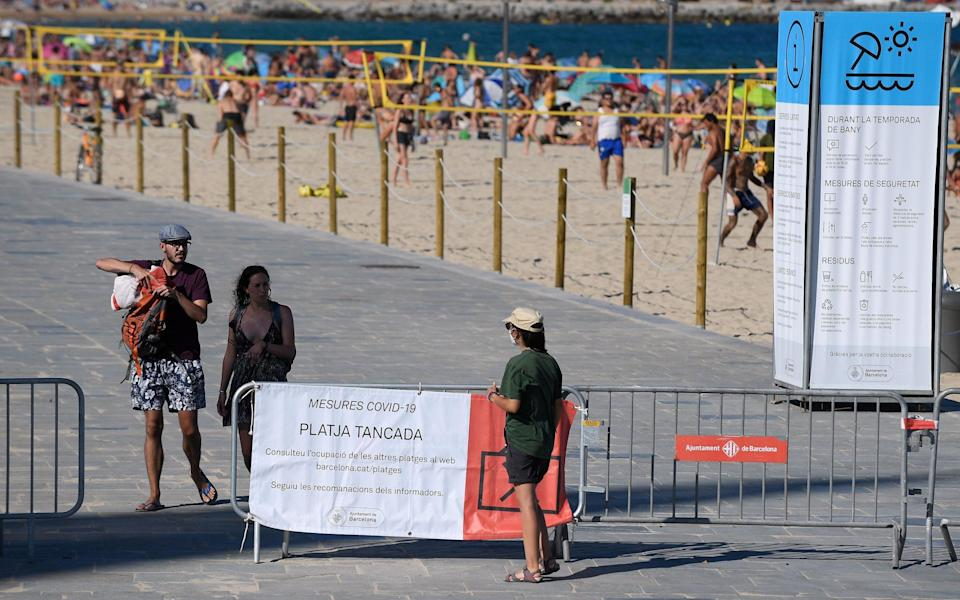 Beaches in Barcelona reached capacity over the weekend, despite new 'stay at home' advice in the city - Getty