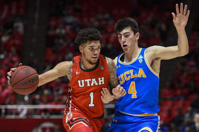 Utah forward Timmy Allen (1) drives as UCLA guard Jaime Jaquez Jr. (4) defends during the second half of an NCAA college basketball game Thursday, Feb. 20, 2020, in Salt Lake City. (AP Photo/Alex Goodlett)