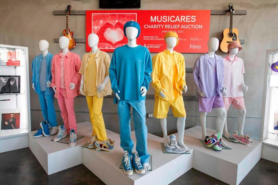 BTS's clothes from the Dynamite video displayed for the auction in January.