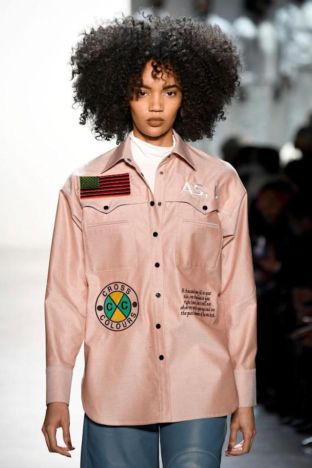 <p>Model wears a blush pink western embroidered shirt with patches at the Pyer Moss FW18 show. (Photo: Getty) </p>
