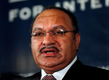 FILE PHOTO: Papua New Guinea's then Prime Minister Peter O'Neill makes an address to the Lowy Institute in Sydney, Australia November 29, 2012. REUTERS/Tim Wimborne/File Photo