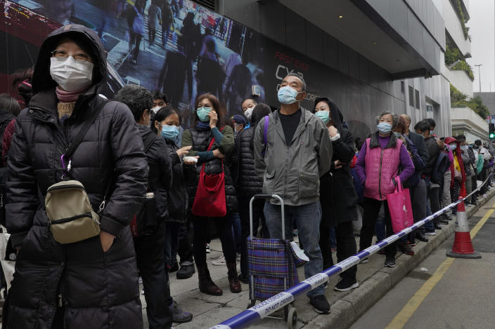 In this Feb. 5, 2020, photo, citizens line up to buy face masks in Hong Kong. The city's often-tumultuous street protests had already slowed in the past two months. Now they have ground to an almost complete halt as attention focuses on how to avoid a recurrence of the SARS pandemic, which killed about 300 people in Hong Kong in 2002-03. (AP Photo/Vincent Yu)