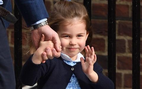 Princess Charlotte waves at photographers as she arrives to meet Prince Louis - Credit: Karwai Tang/WireImage