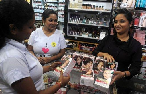 <p>An Indian employee of a cosmetic shop displaying L'Oreal products in Siliguri on September 15. Global cosmetic firms are turning to emerging markets in the hunt for sales, but they face a challenge tailoring their beauty products to suit new customers in India, China and elsewhere.</p>
