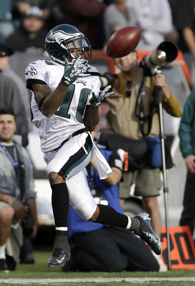 Philadelphia Eagles wide receiver DeSean Jackson (10) catches a 46-yard touchdown pass from quarterback Nick Foles during the third quarter of an NFL football game against the Oakland Raiders in Oakland, Calif., Sunday, Nov. 3, 2013. (AP Photo/Marcio Jose Sanchez)