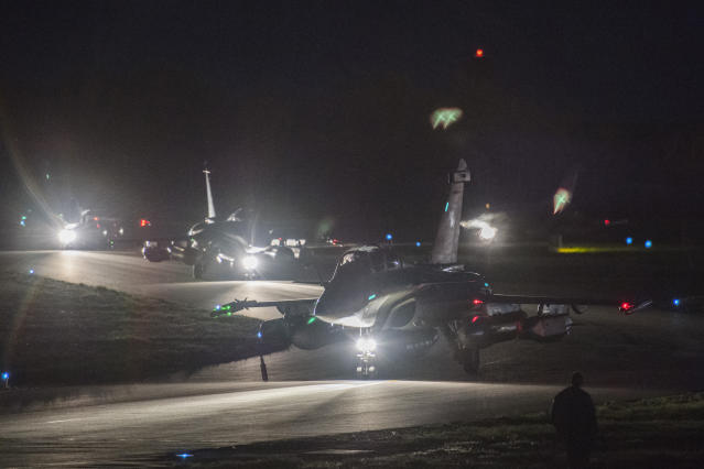 <p>Dassault Rafale fighter aircrafts prepare to take off for airstrikes in Syria from St Didier airbase, eastern France on April 13, 2018. (Photo: French Defense Ministry/ECPAD via AP) </p>