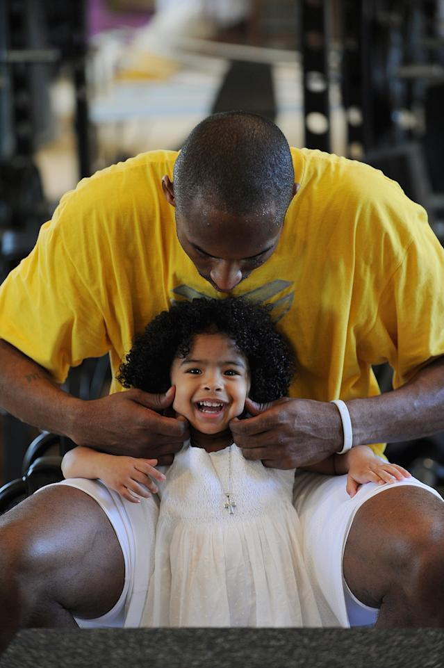 Kobe Bryant of the Los Angeles Lakers pinches his daughter Gianna Bryant's cheeks during a photo session on March 29, 2008 at his home in Newport Beach, California. (Photo by Andrew D. Bernstein/NBAE via Getty Images)