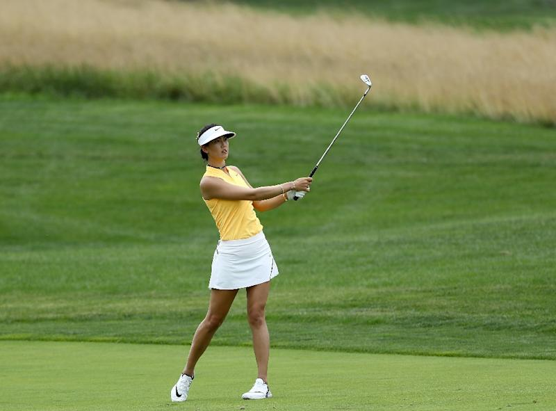 06ed3fcec76 Michelle Wie of the United States takes her shot from the second fairway  during the US