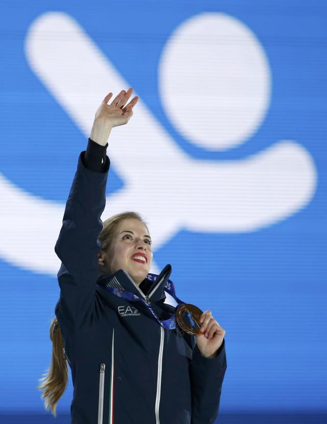 Bronze medallist Italy's Carolina Kostner celebrates during the victory ceremony for the figure skating women's free skating program at the 2014 Sochi Winter Olympics February 21, 2014. REUTERS/Issei Kato (RUSSIA - Tags: OLYMPICS SPORT FIGURE SKATING)