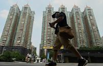 The once-mighty Evergrande Group has long been the face of Chinese real estate, surfing a decades-long property boom to expand into more than 280 Chinese cities (AFP/Noel Celis)