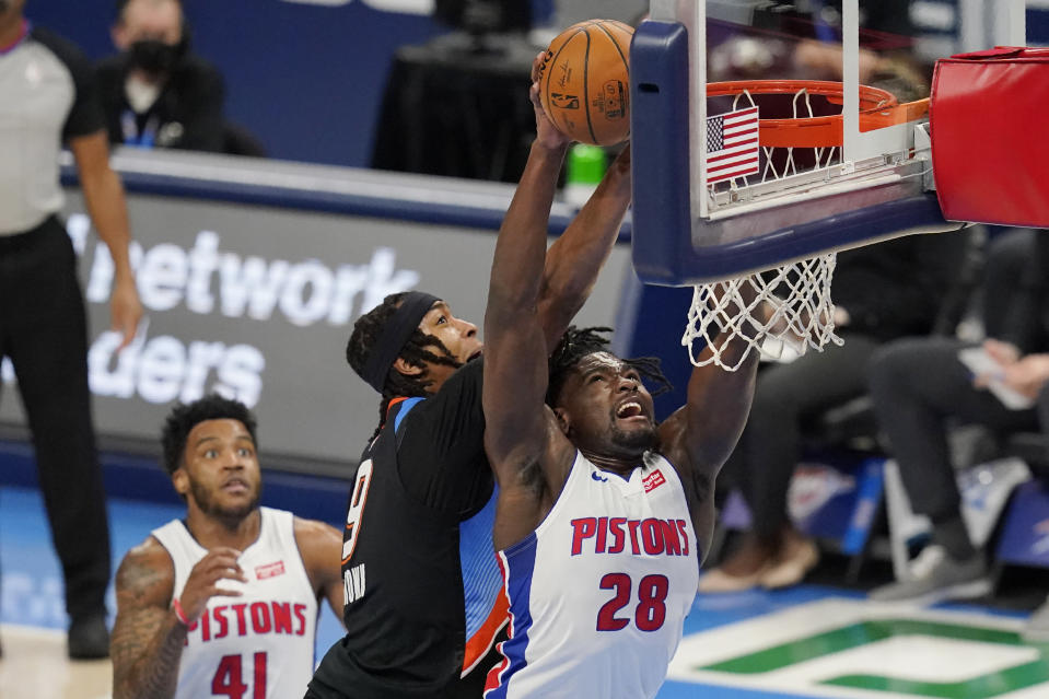 Detroit Pistons center Isaiah Stewart (28) grabs a rebound in front of Oklahoma City Thunder center Moses Brown (9) in the first half of an NBA basketball game Monday, April 5, 2021, in Oklahoma City. (AP Photo/Sue Ogrocki)