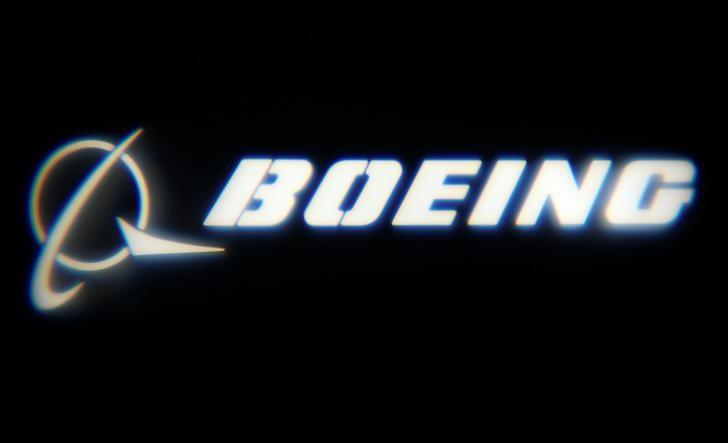 """The Boeing Company logo is projected on a wall at the """"What's Next?"""" conference in Chicago"""