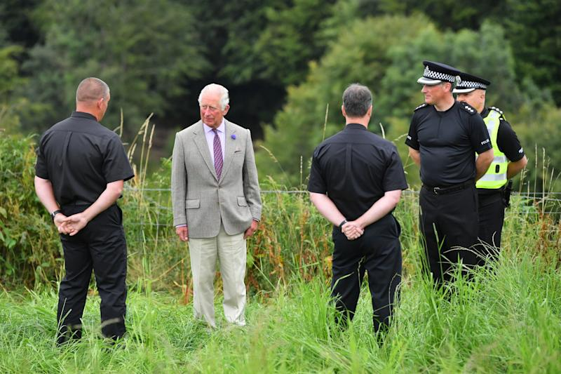 The Prince of Wales meets first responders who attended the scene of the ScotRail train derailment near Stonehaven, Aberdeenshire, which cost the lives of three people on Wednesday. PA Photo. Picture date: Friday August 14, 2020. See PA story RAIL Stonehaven. Photo credit should read: Ben Birchall/PA Wire