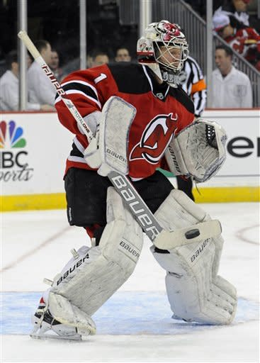 New Jersey Devils goaltender Johan Hedberg, of Sweden, makes a save during the first period of an NHL hockey game against the Philadelphia Flyers, Wednesday, March 13, 2013, in Newark, N.J. (AP Photo/Bill Kostroun)