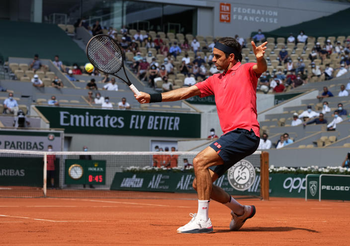 Switzerland's Roger Federer plays a return to Croatia's Marin Cilic during their second round match on day 5, of the French Open tennis tournament at Roland Garros in Paris, France, Thursday, June 3, 2021. (AP Photo/Michel Euler)