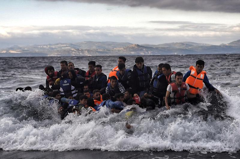 Refugees and migrants arrive at the Greek island of Lesbos after crossing the Aegean sea from Turkey on October 2, 2015