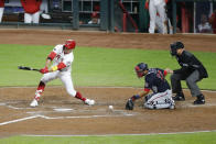 Cincinnati Reds' Joey Votto, left, strikes out with bases loaded during the fifth inning of a baseball game against the Washington Nationals, Thursday, Sept. 23, 2021, in Cincinnati. (AP Photo/Jay LaPrete)