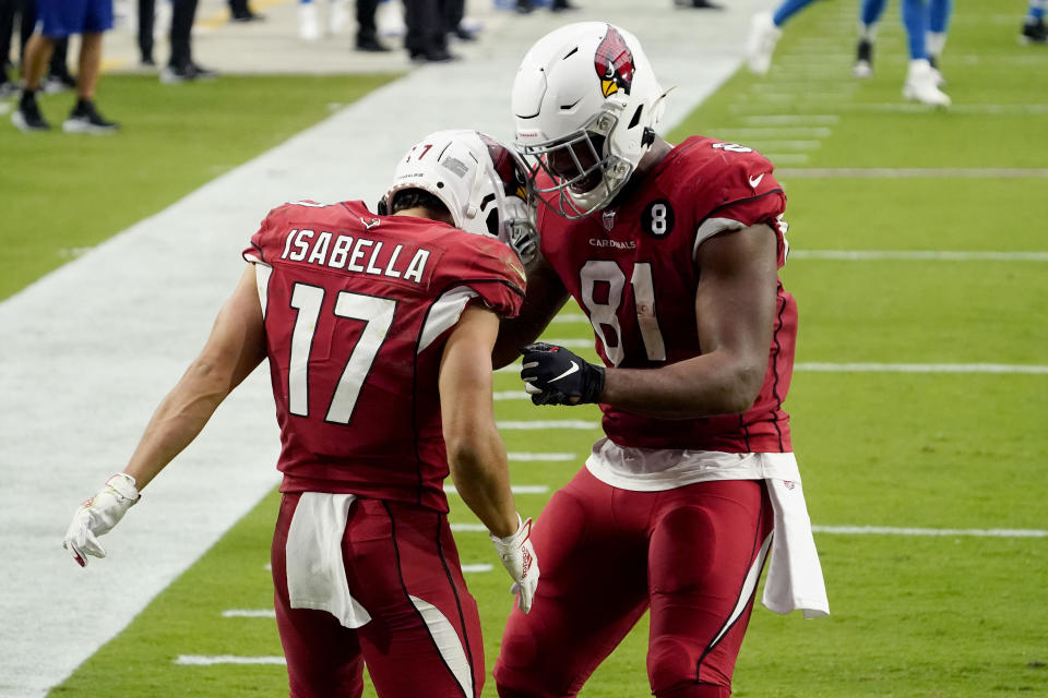 Arizona Cardinals wide receiver Andy Isabella (17) celebrates his touchdown against the Detroit Lions with tight end Darrell Daniels (81) during the second half of an NFL football game, Sunday, Sept. 27, 2020, in Glendale, Ariz. (AP Photo/Rick Scuteri)