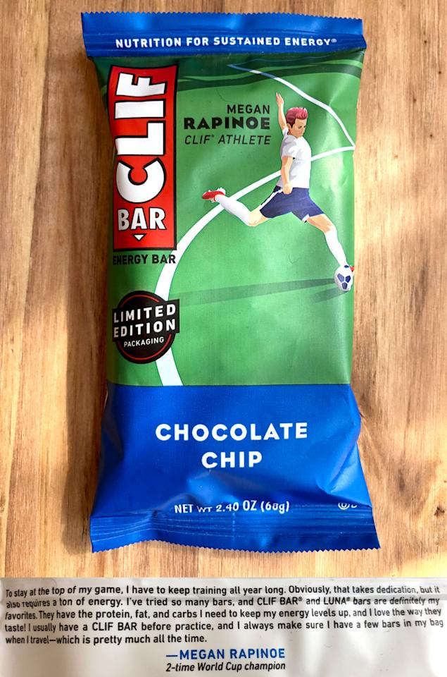 """<p>If you're a soccer fan, you'll want to stock up on Clif Bar Chocolate Chip bars - they feature two-time World Cup champion <a href=""""https://www.popsugar.com/fitness/Who-Megan-Rapinoe-46253077"""" class=""""ga-track"""" data-ga-category=""""Related"""" data-ga-label=""""https://www.popsugar.com/fitness/Who-Megan-Rapinoe-46253077"""" data-ga-action=""""In-Line Links"""">Megan Rapinoe</a>. With her iconic pink hair on display, you can definitely feel Rapinoe's bold yet positive energy bursting from this illustration.</p>"""