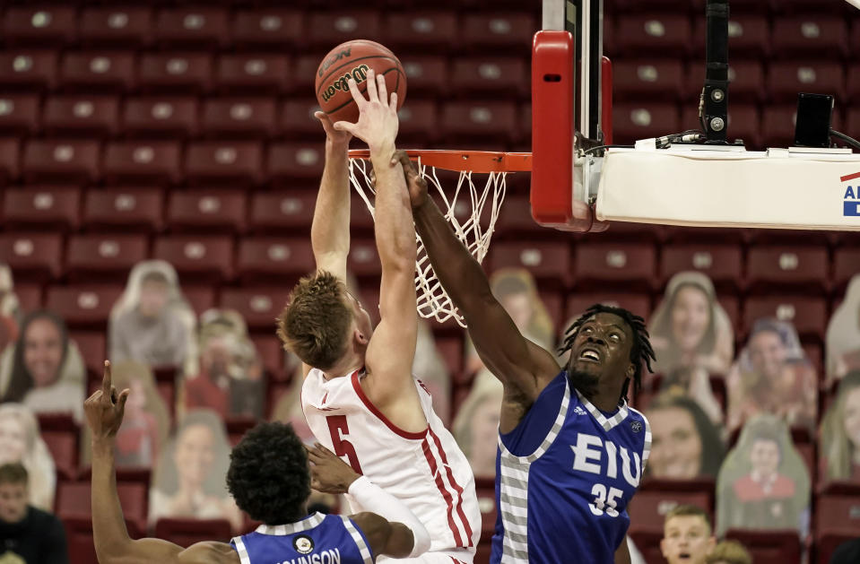 Eastern Illinois' George Dixon (35) defends against Wisconsin's Tyler Wahl (5) during the second half of an NCAA college basketball game Wednesday, Nov. 25, 2020, in Madison, Wis. Wisconsin won 77-67. (AP Photo/Andy Manis)