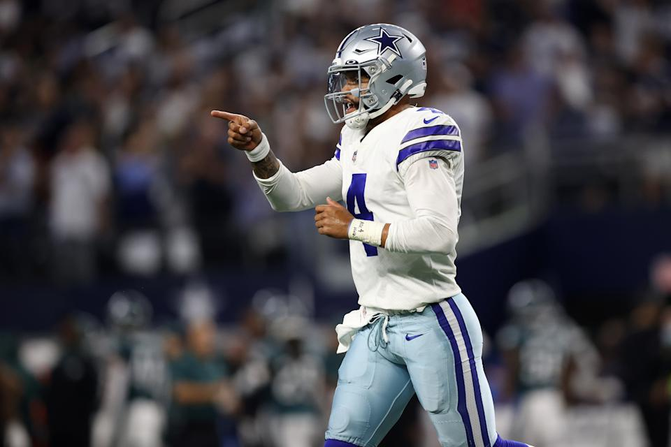 ARLINGTON, TEXAS - SEPTEMBER 27: Dak Prescott #4 of the Dallas Cowboys reacts to a first quarter pass while playing the Philadelphia Eagles at AT&T Stadium on September 27, 2021 in Arlington, Texas. (Photo by Tom Pennington/Getty Images)
