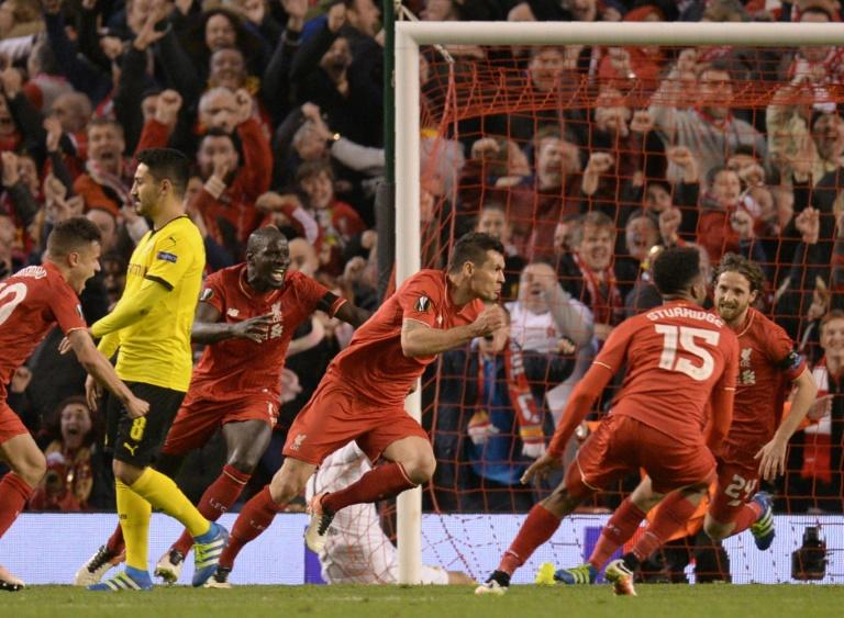 Liverpool's Dejan Lovren (centre) celebrates after scoring the winning goal in the Europa League quarter-final against Borussia Dortmund at Anfield on April 14, 2016