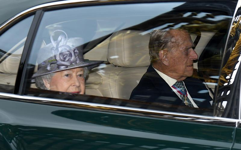 Queen Elizabeth II and Prince Philip, the Duke of Edinburgh, depart in their car - Credit: Leon Neal/Getty Images