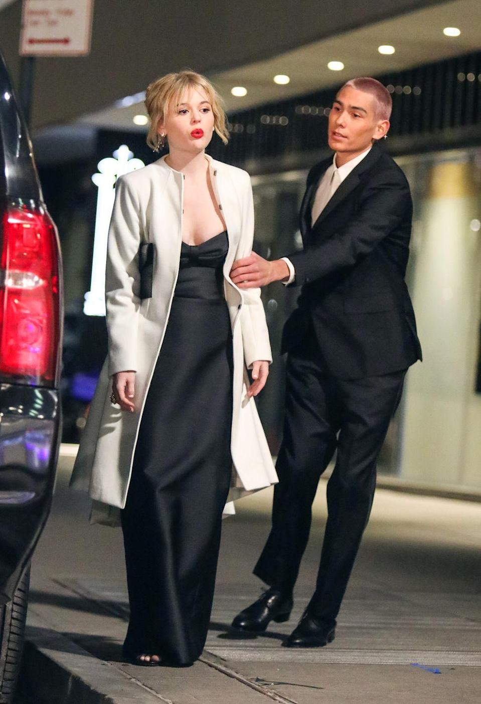 <p>Emily Alyn Lind and a suited-up Evan Mock share a scene together. </p>