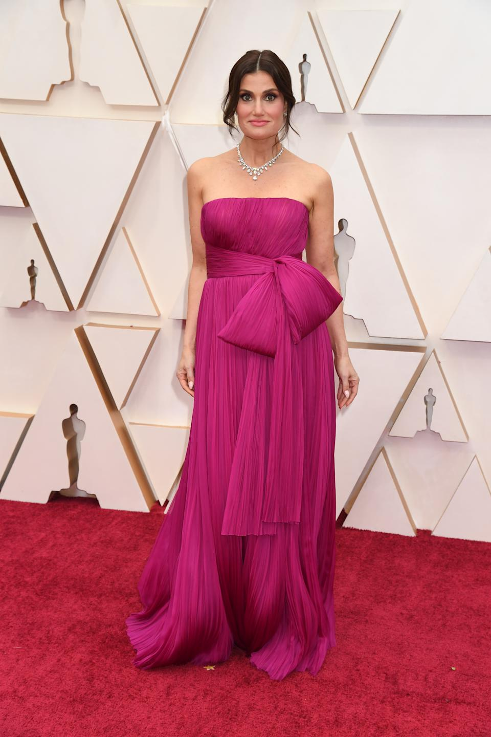 """The """"Frozen II"""" star arrived on the red carpet in a fuchsia gown by J. Mendel and Harry Winston diamonds before taking the stage to perform the film's Oscar nominated song """"Into the Unknown."""""""