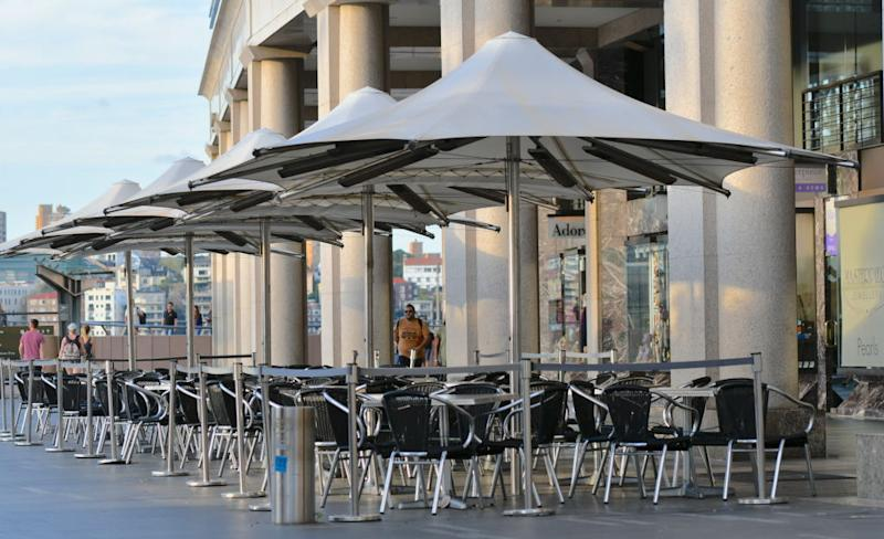 A empty restaurant tables is seen at Circular Quay in Sydney on Sunday. Source: Getty
