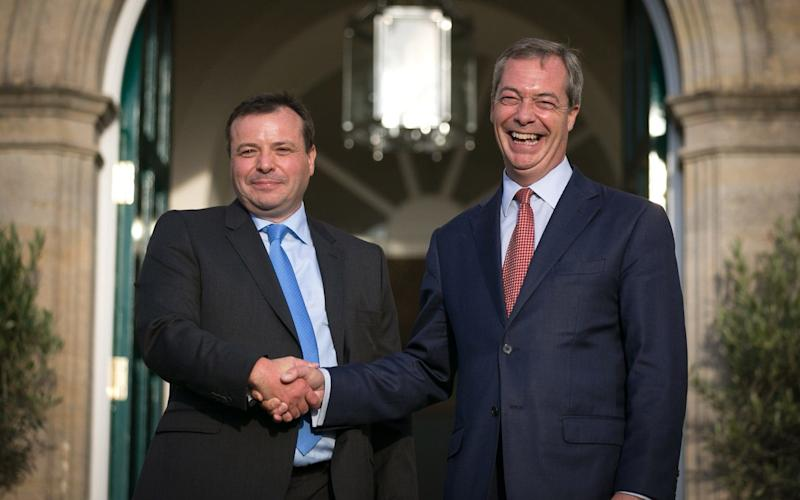Nigel Farage holds a press conference with donor Arron Banks - Credit: Matt Cardy/Getty Images