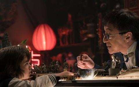 Jackie Chan appears in the film's live-action scenes - Credit: Warner Bros