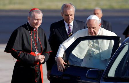 Pope Francis is welcomed by Vatican State Secretary Cardinal Parolin before boarding a plane at Fiumicino airport in Rome