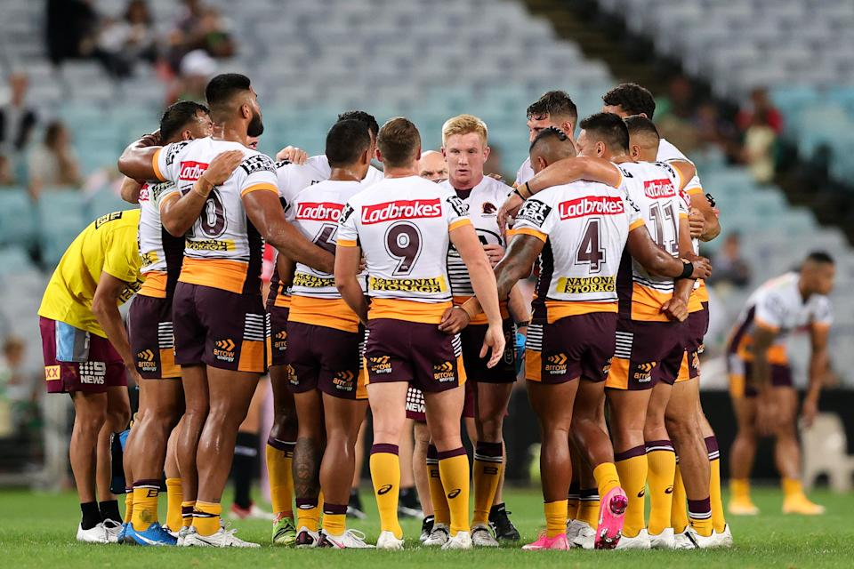 Broncos in a huddle during the round five NRL match between the South Sydney Rabbitohs and Brisbane Broncos at Stadium Australia on April 08, 2021 in Sydney, Australia.