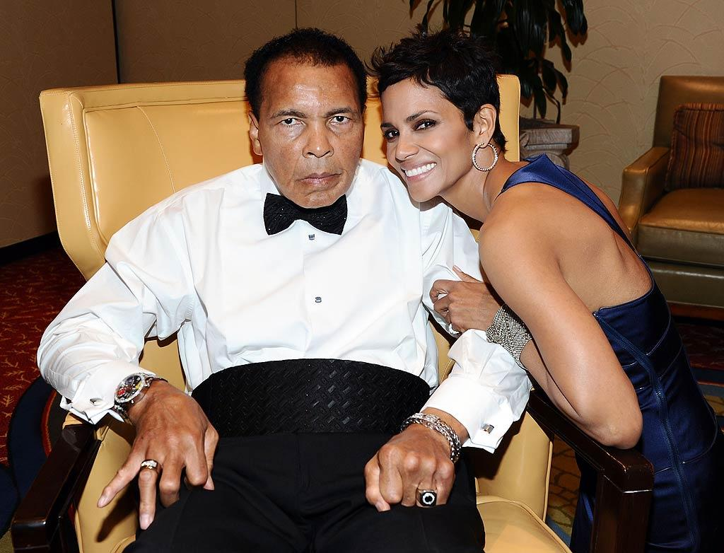 """Boxing legend Muhammad Ali hosted his annual Celebrity Fight Night XVII in Phoenix, Arizona, Saturday night to benefit the St. Joseph's Muhammad Ali Parkinson Center. A stunning Halle Berry, who was honored for her work with the foundation, joked during her speech, """"I would have been better off not marrying all these other men. I should have married Muhammad Ali instead!'' Michael Buckner/<a href=""""http://www.gettyimages.com/"""" target=""""new"""">GettyImages.com</a> - March 19, 2011"""