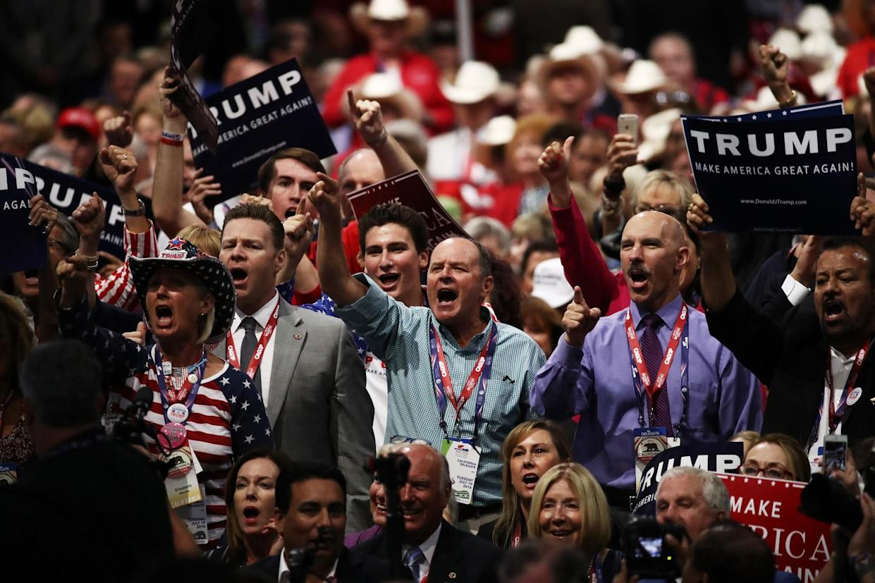 """Delegates yell, """"Guilty!"""" as they participate during New Jersey Gov. Chris Christie's speech on the second day of the Republican National Convention. (Photo: Win McNamee/Getty Images)"""