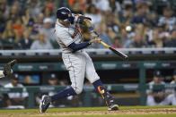 Houston Astros' Carlos Correa (1) hits a two-run single against the Detroit Tigers in the fifth inning of a baseball game in Detroit, Thursday, June 24, 2021. (AP Photo/Paul Sancya)