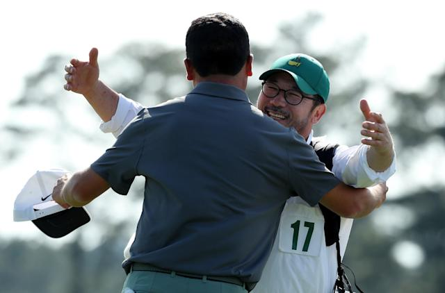 Doug Ghim of the U.S. gets a hug from his father, who was his caddie, as he finishes first round play on the 18th green at the 2018 Masters golf tournament at the Augusta National Golf Club in Augusta, Georgia, U.S., April 5, 2018. REUTERS/Lucy Nicholson