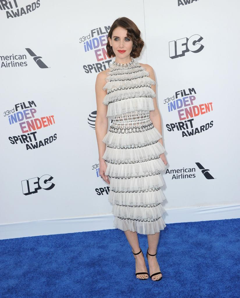<p>In a look far from her <em>Glow</em> character, Brie looked more Trudie Campbell on the red carpet in a white fringed gown. (Photo: Getty Images) </p>